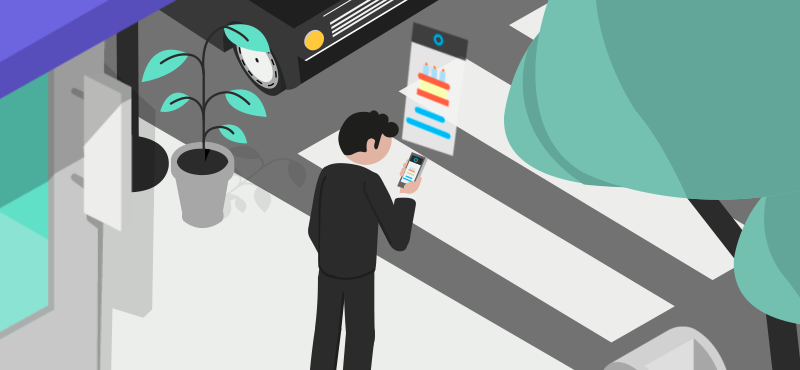 Bărbat uitându-se la telefon pe un trotuar