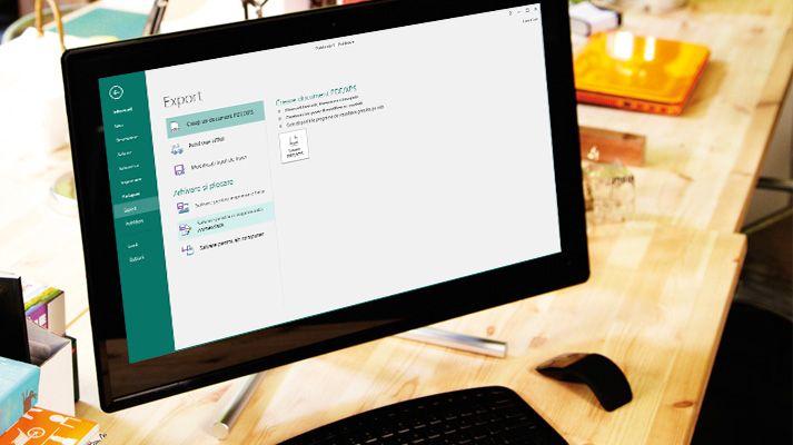 Un computer PC ce afișează o publicație Publisher deschisă, cu opțiuni de trimitere prin e-mail afișate în panglică.