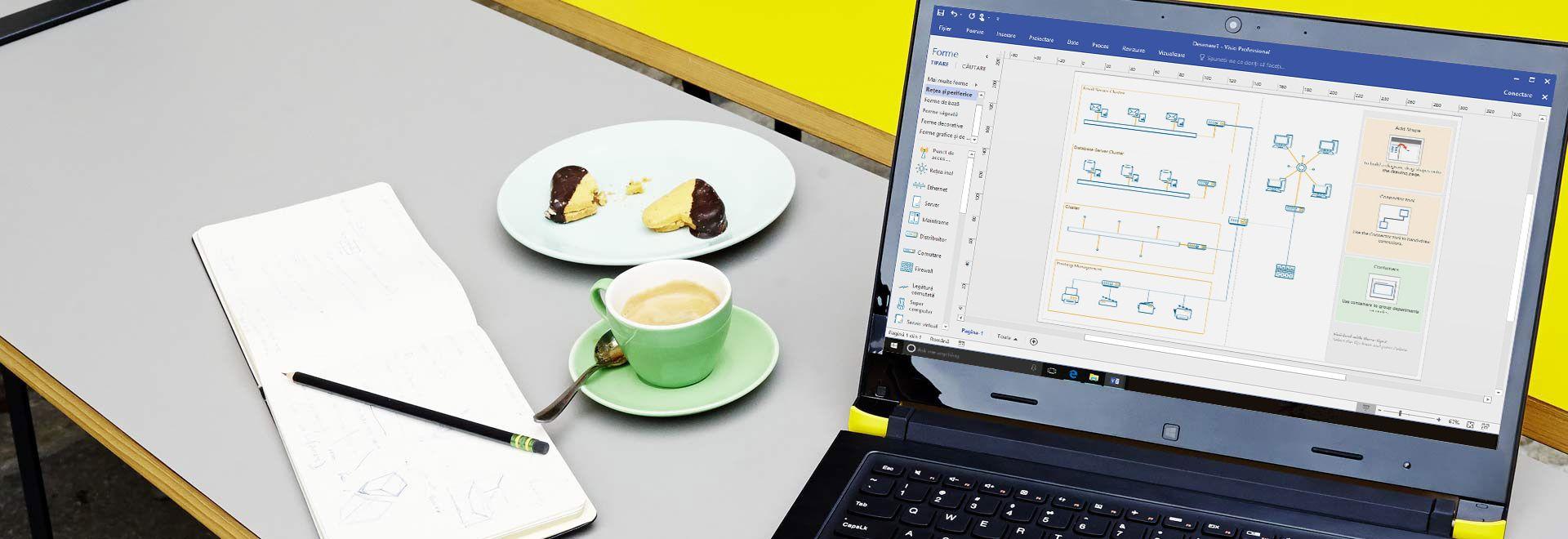 Prim-plan cu un laptop așezat pe o masă, afișând o diagramă Visio cu panglica de editare și panoul