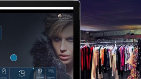 Женское лицо на планшете и платья на заднем плане