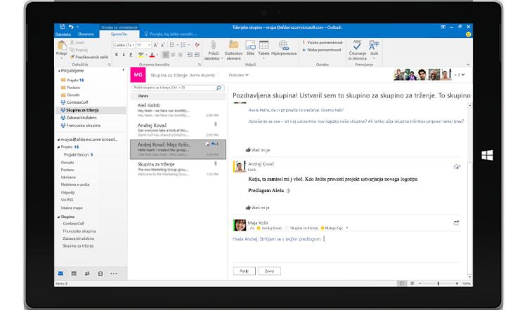 Tablični računalnik, na katerem je prikazan pogovor skupine v Outlooku