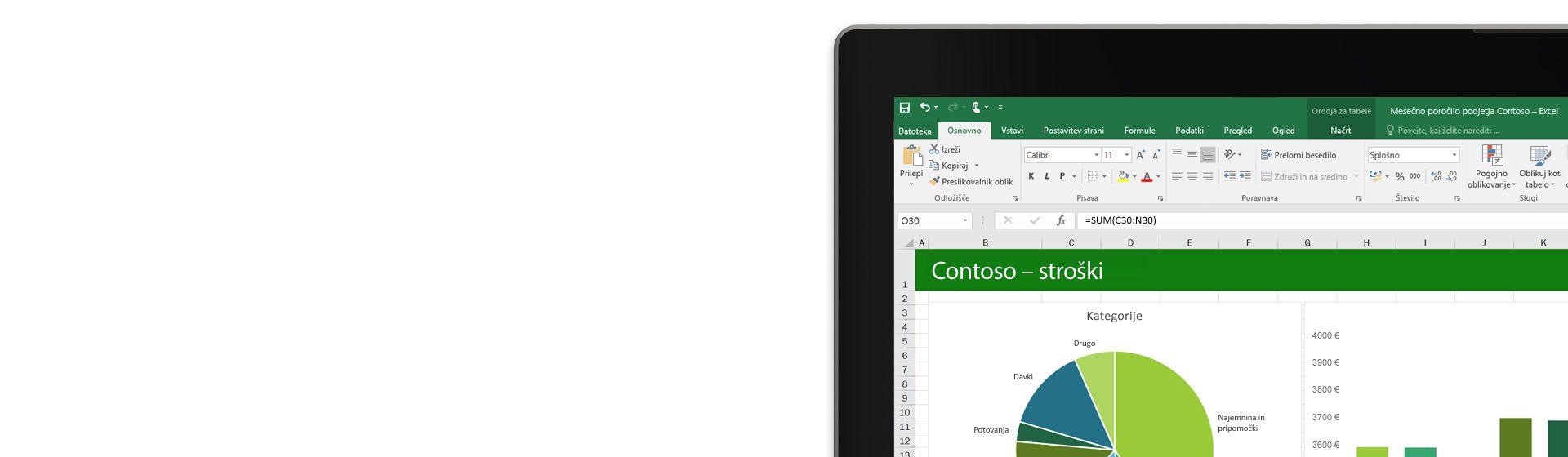 Prenosni računalnik prikazuje Microsoft Excelovo preglednico z grafikonom.