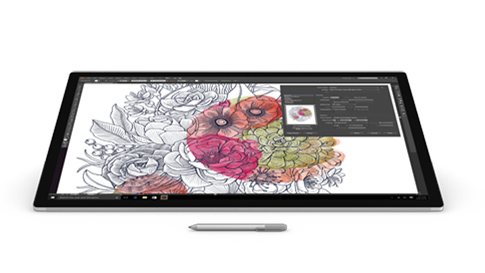 Adobe Illustrator CC på skärmen på en Surface Studio, med Surface-pennan.