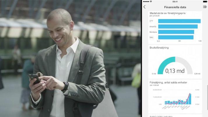 En man som går och tittar på sin telefon, en del av skärmen visar en dataöversikt.