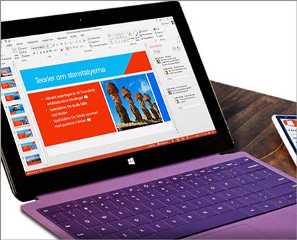 En surfplatta som visar samtidig redigering av en PowerPoint-presentation i realtid.