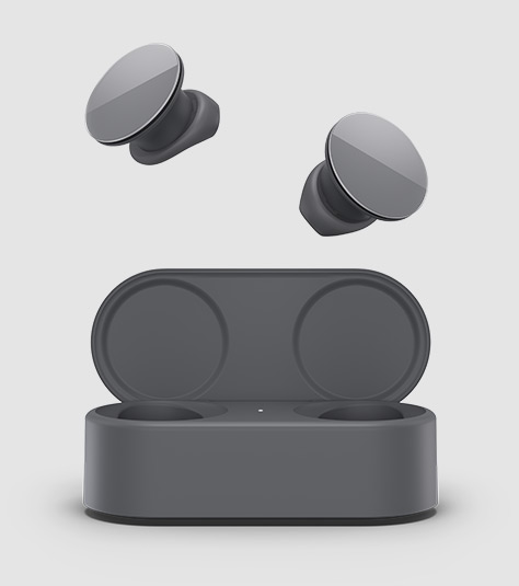 Surface Earbuds som sticker ut ur sitt laddningsfodral