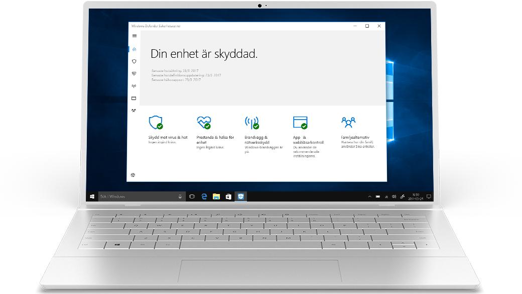 Silverfärgad laptop med Defender-appen på skärmen