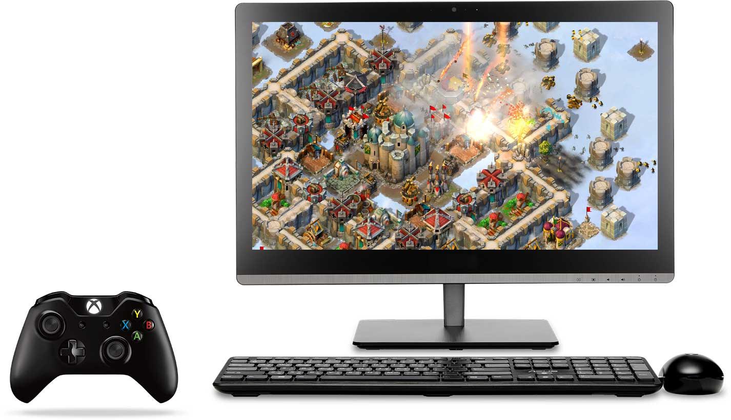 Xbox-handkontroll och allt-i-ett-enhet med Xbox på skärmen