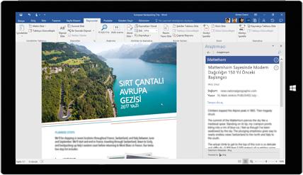 Sırt çantasıyla Avrupa'ya yapılan seyahatlerle ilgili bir belgede Word Araştırmacı'nın kullanıldığını gösteren tablet ekranı, yerleşik Office araçlarıyla belge oluşturmayı öğrenin