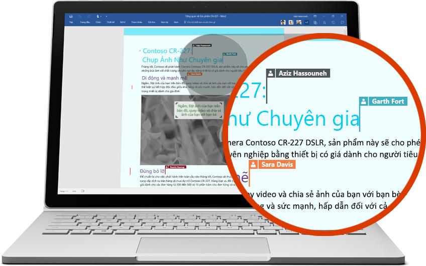 Máy tính xách tay hiển thị một vài người dùng đang cộng tác trên một tài liệu Word