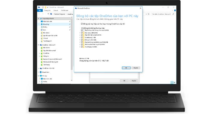 Một máy tính xách tay hiển thị cận cảnh tính năng đồng bộ của OneDrive for Business