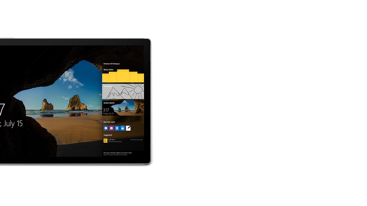 屏幕上激活了 Windows Ink 工作区的 Surface Book 锁屏界面图像。