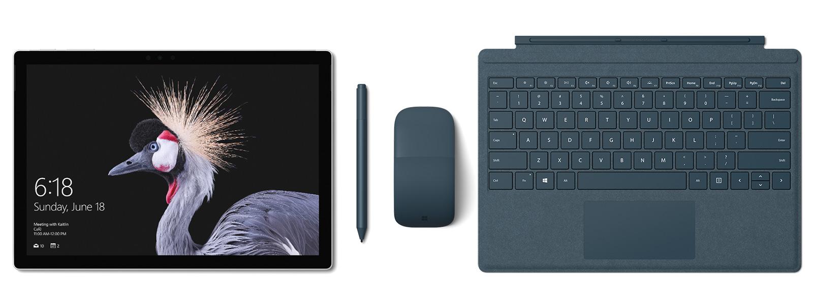 带灰钴蓝 Surface Pro 特制版专业键盘盖、Surface 触控笔和 Surface Arc Mouse 的 Surface Pro 的图像。Surface 触控笔陪伴左右。
