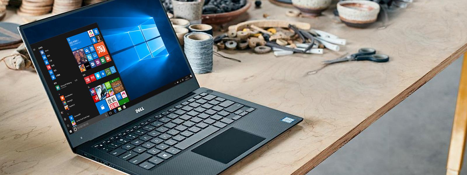 "呈现 Windows 10""开始""屏幕的 Dell XPS 13"