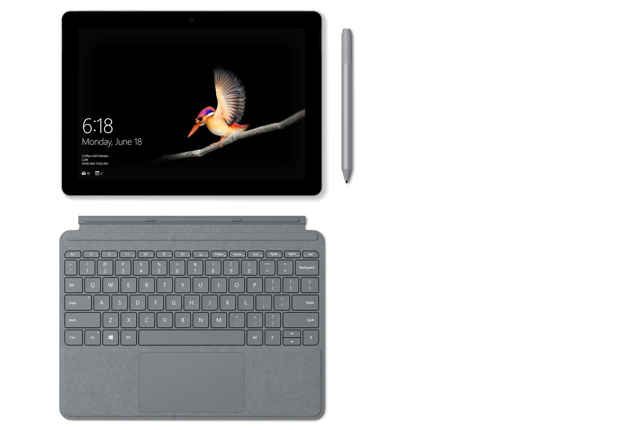 配备 Surface 专业键盘盖、Surface 触控笔和 Surface Arc 鼠标的 Surface Go 。