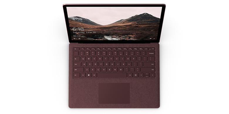 深紫红 Surface Laptop 电脑的俯视图