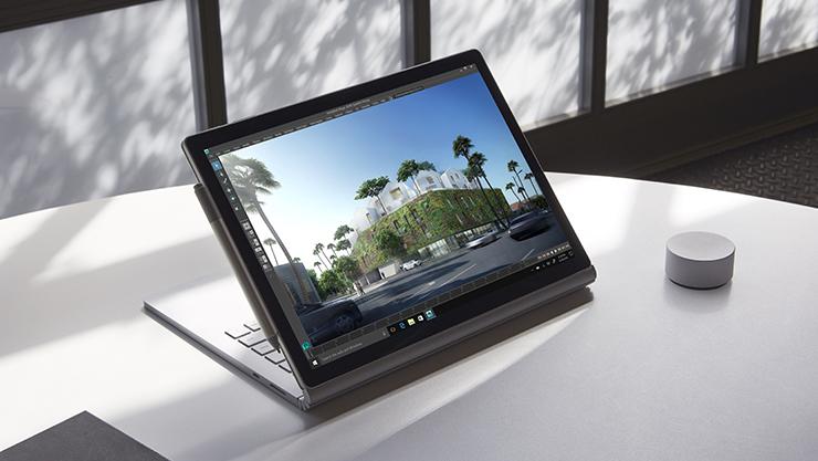 處於檢視模式的 Surface Book 2,以及 Surface 手寫筆和 Surface Dial。
