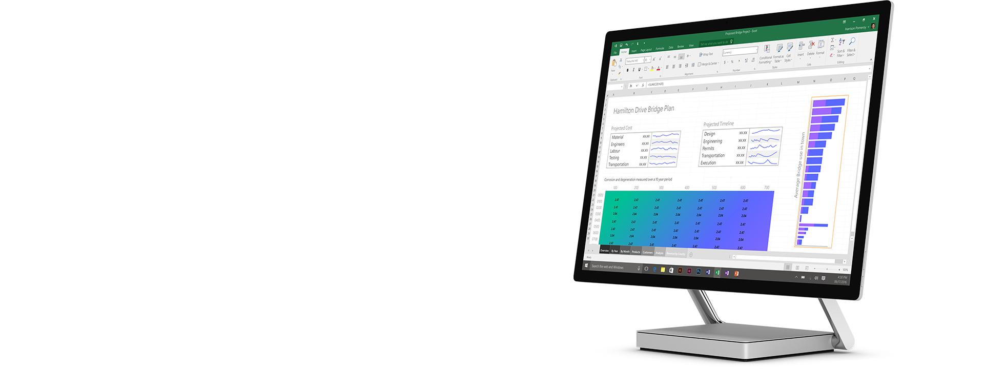 Surface Studio 採用桌上型電腦模式,並且螢幕上顯示已開啟的 Excel 試算表