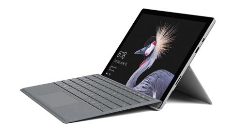 Surface Pro 筆記型電腦與實體鍵盤保護蓋。