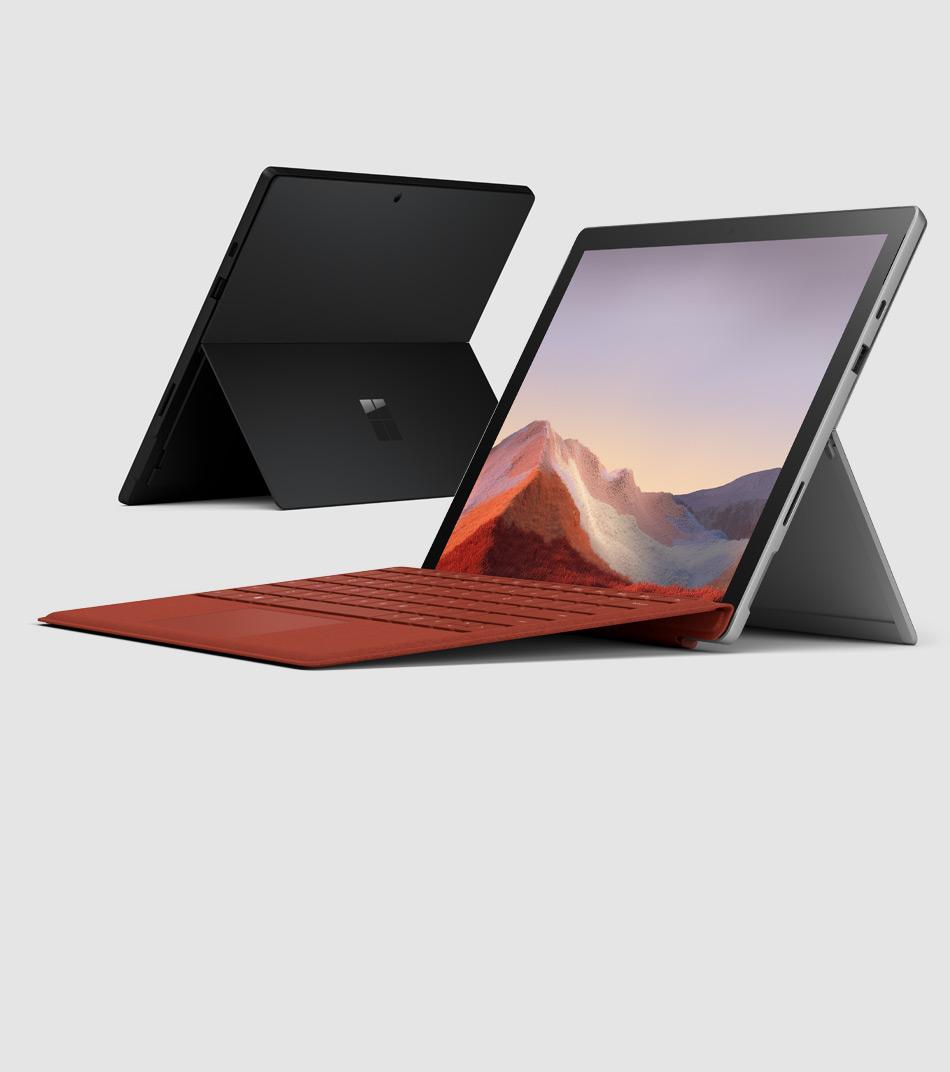 配備罌粟紅實體鍵盤保護蓋的 Surface Pro 7,旁邊有霧黑色 Surface Pro 7